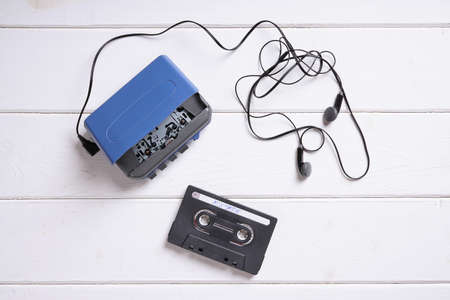 vintage walkman or cassette player with earbuds and mix tape Standard-Bild
