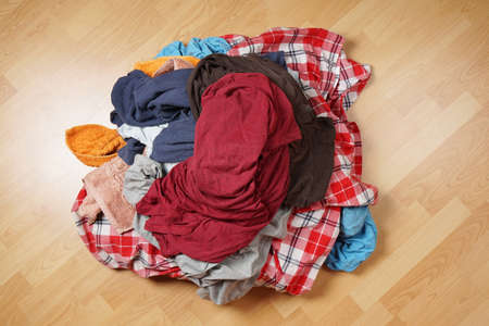 messy clothes: top view of dirty laudry pile on floor Stock Photo