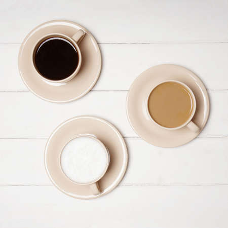 top view of selection of different coffee drinks in cups. black, flat white and cafe latte. Stock Photo