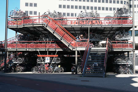 Groningen, Netherlands - May 27, 2017: Multistory bicycle parking facilities are located next to the train station. Editöryel