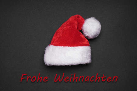 weihnachtsmann: Frohe Weihnachten meaning merry christmas in German, xmas card design with santa hat