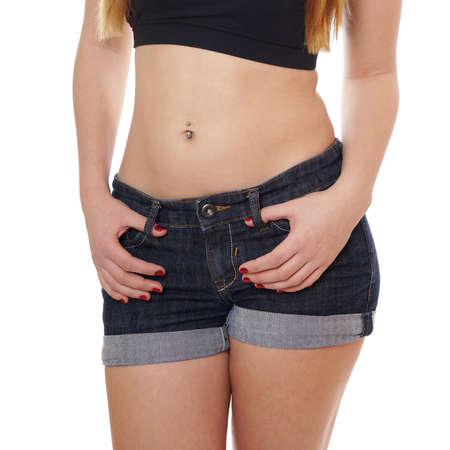 midsection of girl in denim hot pants and crop top