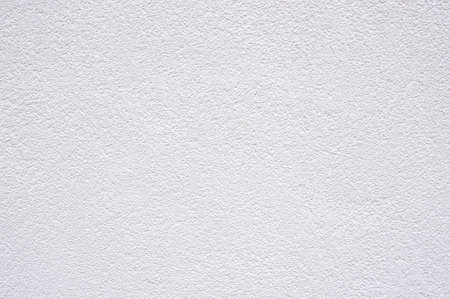 white roughcast plaster wall background texture pattern Stock Photo