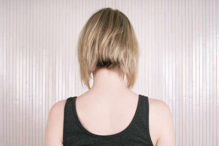 rear view of a blonde woman with lob or long bob haircut Stock Photo