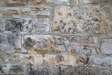 old weathered natural stone wall masonry background texture Stock Photo