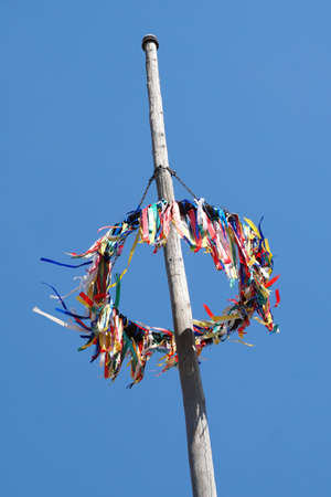 traditional german maypole against blue sky, may day celebration in Germany
