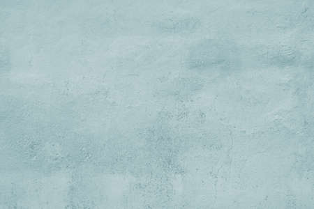 Light blue wall background texture pattern with cracked plaster