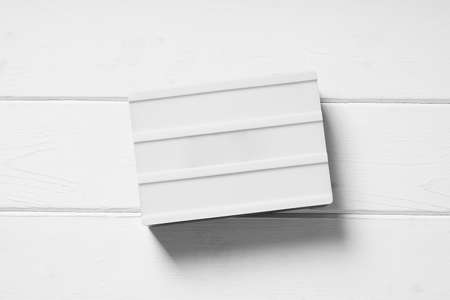 blank light box sign on white wooden background Stock Photo