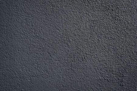 black or dark gray wall roughcast plaster background texture pattern Stock Photo