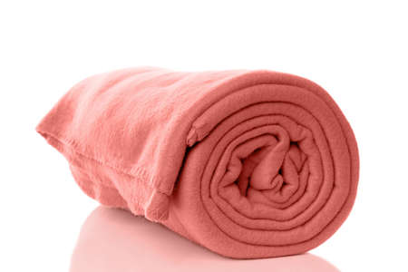 rolled up fleece blanket in coral trend color of the year 2019 Banco de Imagens