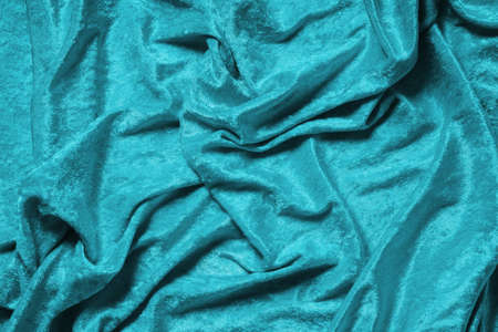cyan blue or turquoise panne velvet drape background texture