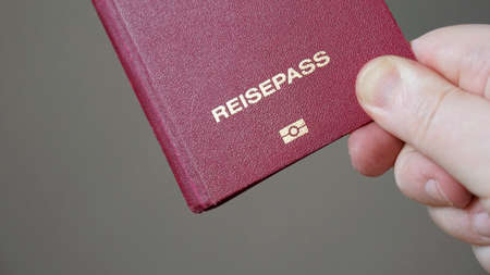 Reisepass is German for passport - hand holding biometric e-passport from Germany Banque d'images - 122167650