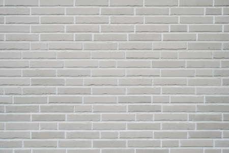 grauer Klinkermauerhintergrund - moderne Gebäudefassade mit Klinkerriemchenverkleidung
