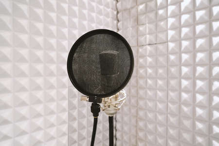 microphone with pop filter on mic stand in soundproof isolation booth for vocal recording at sound studio 스톡 콘텐츠