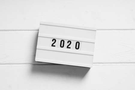 year 2020 on light box sign - minimalist preview or review concept