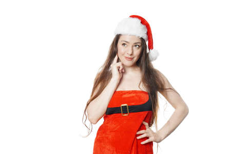 sassy dreamy miss santa dressed in christmas costume thinking - isolated on white background