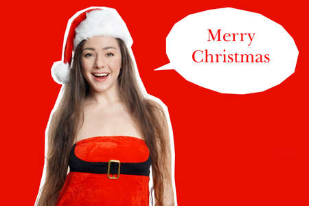 miss santa claus with merry christmas greeting in speech bubble Stock Photo