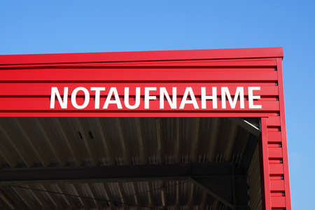 Notaufnahme translates as accident and emergency or casualty department in German - sign on hospital roof Stock fotó