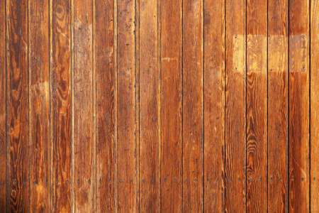old rustic wood paneling background with vertical wooden boards or planks