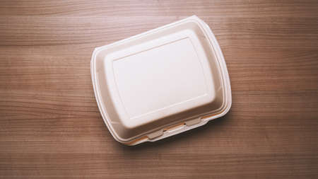 take-away box or take-out foam container from food delivery service on wooden table 版權商用圖片