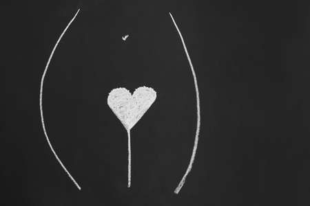 heart shape pubic hair style or hairstyle - simple minimalist line drawing with chalk on blackboard 版權商用圖片