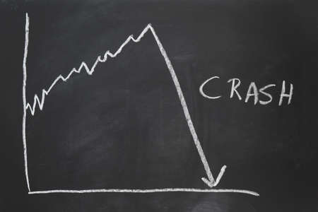 stock market crash - economy crisis - hand-drawn graph on chalkboard