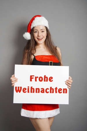 Frohe Weihnachten - female santa wishing merry christmas in German