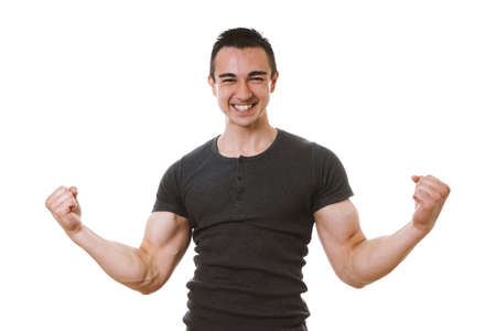 muscular young man celebrating success in winner pose with flexed muscles and clenched fists