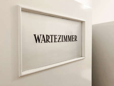 Wartezimmer is german for waiting room - sign on door in GP or doctors practice