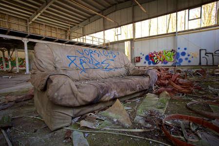 industrie: rotten sofa in industrie ruin Stock Photo