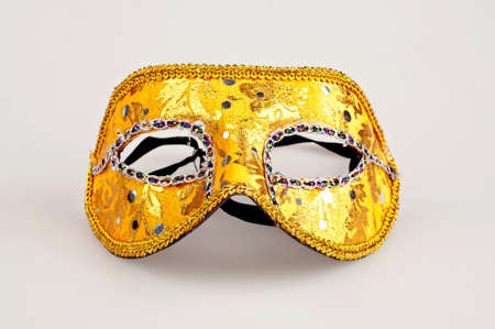 golden carnival mask on white background photo