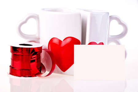 Coffee mugs in shape of hear and red ribbon Stock Photo