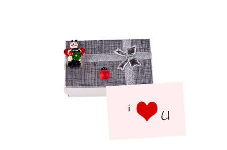 gift box with ladybugs and pink postcard with heart photo