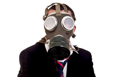 a business man with gas mask over white background photo