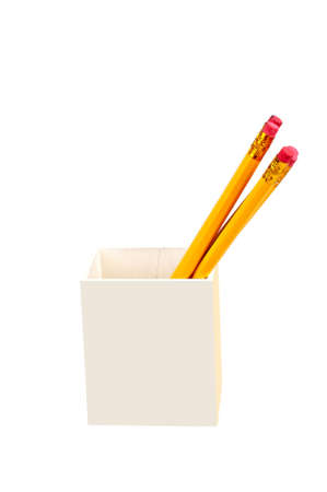 writing implements: wooden pencils holder isolated on a white background Stock Photo