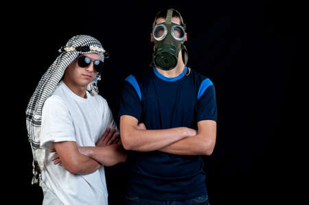 Young Arab with sunglasses and a young man with gas mask photo