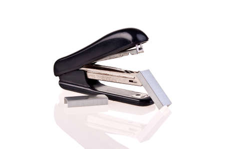 old rusty stapler whit staples on white background photo