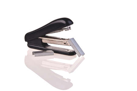 rusty stapler whit staples on white background photo