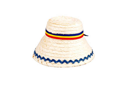 traditional Romanian hat made of straws, isolated against a white background photo