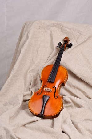 Violin on beige background photo
