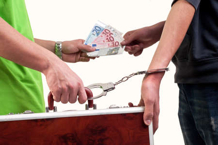 Business transfer deal  exchange between money and suitcase caught by hand with handcuffs photo