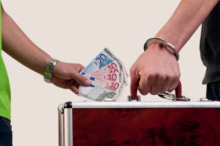 business transfer deal  handover of a suitcase for money photo