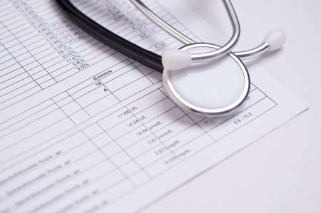 closeup of a black stethoscope on a medical analysis Stock Photo