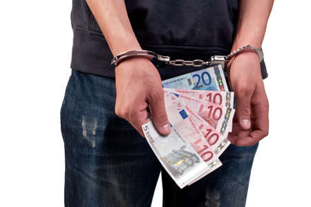 man in handcuffs is holding money over white background photo