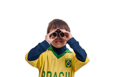 Portrait of a boy with binoculars over white background photo