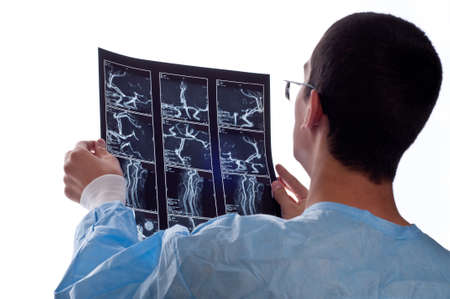 surgeon looking at CT computer tomography scan image