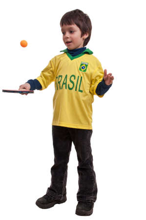 beautiful boy playing with table tennis racket and ball