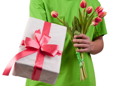 Gift box and fresh  tulips in man s hands