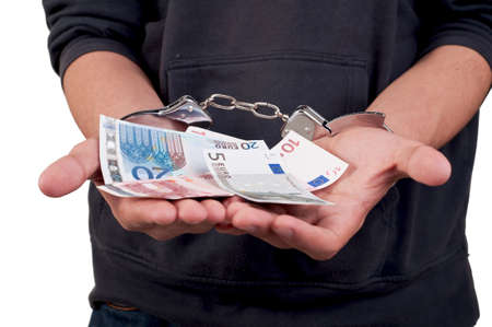 Man in handcuffs holding money photo