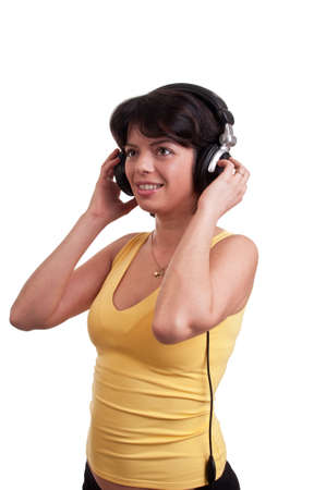 Beautiful brunette woman is listen to the music at headphones Stock Photo